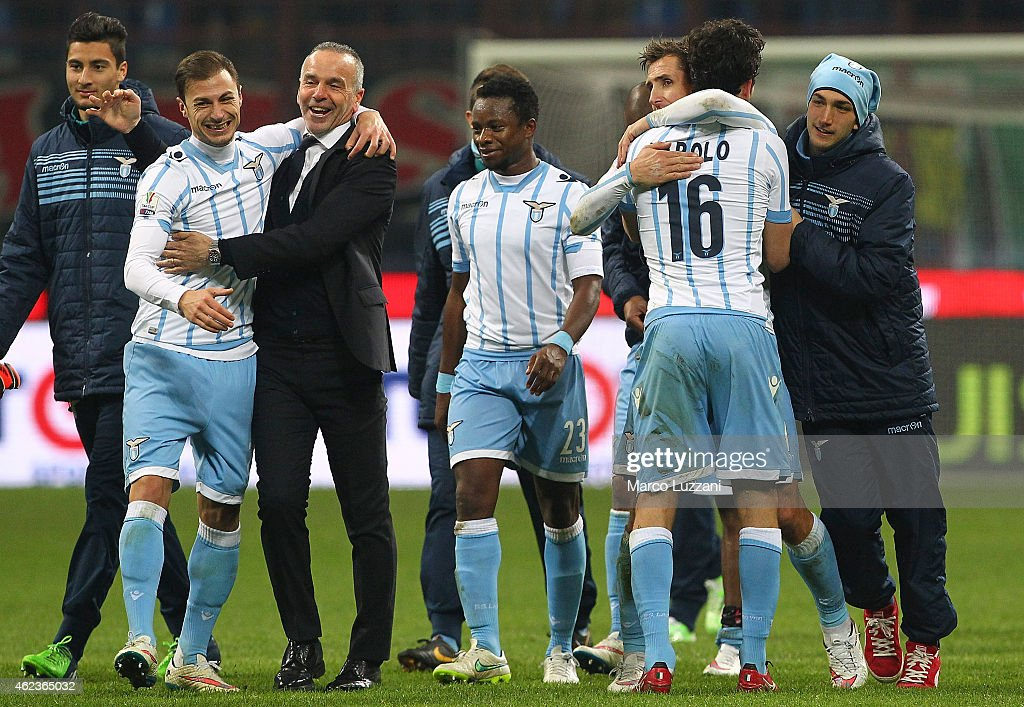 Players of the SS Lazio celebrate a victory at the end of the TIM Cup match between AC Milan and SS Lazio at Stadio Giuseppe Meazza on January 27, 2015 in Milan, Italy.
