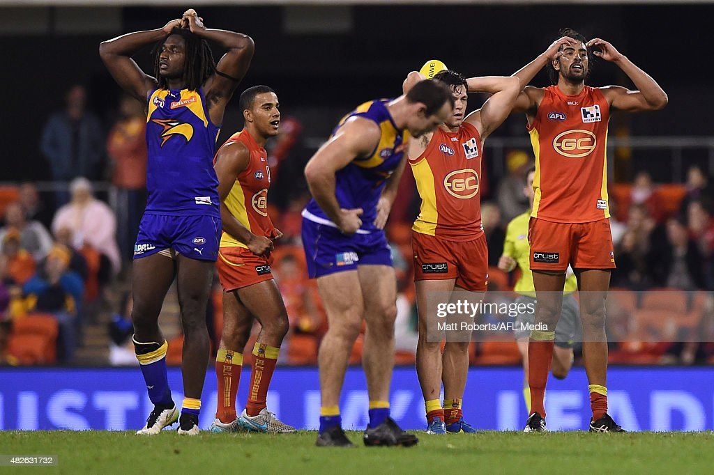 Players of the Suns and the Eagles look dejected during the round 18 AFL match between the Gold Coast Suns and the West Coast Eagles at Metricon Stadium on August 1, 2015 in Gold Coast, Australia.
