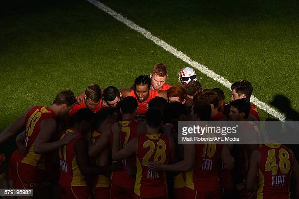 Players of the Suns huddle during the round 18 AFL match between the Gold Coast Suns and the Fremantle Dockers at Metricon Stadium on July 23 2016 in...