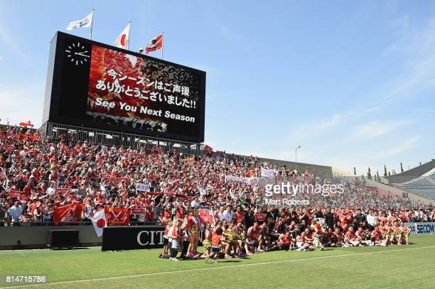 Players of the Sunwolves pose for a team photograph with fans during the Super Rugby match between the Sunwolves and the Blues at Prince Chichibu...