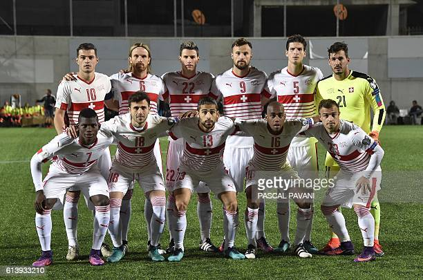 Players of the Swiss national team Breel Embolo Admir Mehmedi Ricardo Rodriguez Gelson Fernandes and Xherdan Shaqiri second row Granit Xhaka Micheal...