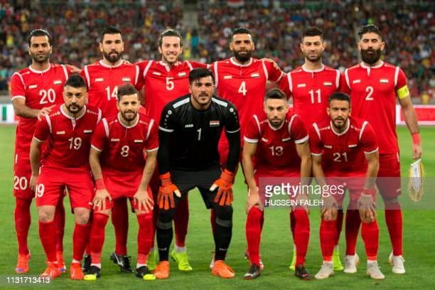 Players of the Syrian national football team line-up ahead of the international friendly football match between Iraq and Syria at the Basra Sports...