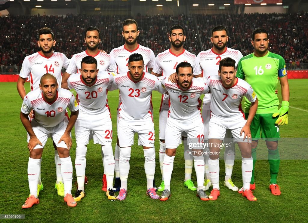 Players of the Tunisian national football team line up during the World Cup 2018 qualifying football match against Libya on November 11, 2017 at the Rades Olympic Stadium in Tunis. /