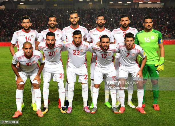Players of the Tunisian national football team line up during the World Cup 2018 qualifying football match against Libya on November 11 2017 at the...