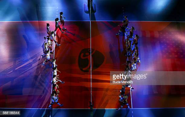 Players of the United States and Serbia enter in the court during the women's qualifying volleyball match between the United States and Serbia on Day...