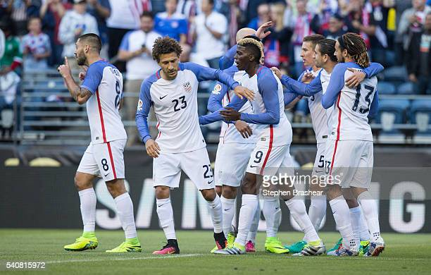 Players of the United States celebrate their first goal scored by Clint Dempsey during a Quarterfinal match between USA and Ecuador at CenturyLink...