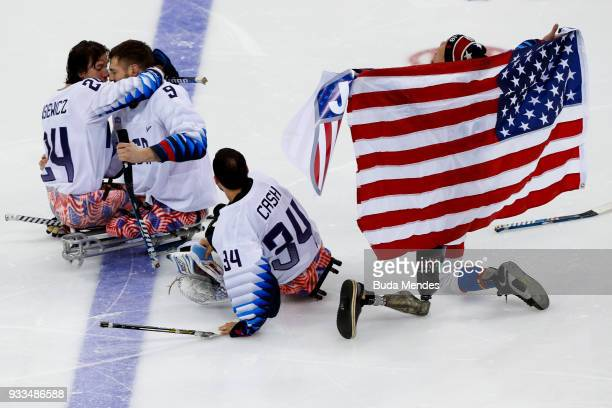 Players of the United States celebrates the gold medal after winning in the Ice Hockey gold medal game between United States and Canada during day...
