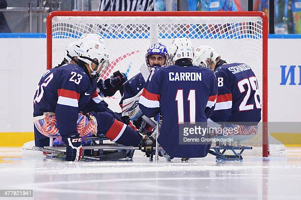 Players of the United States come together prior to the second period of the Ice Sledge Hockey Preliminary Round Group B match between the United...