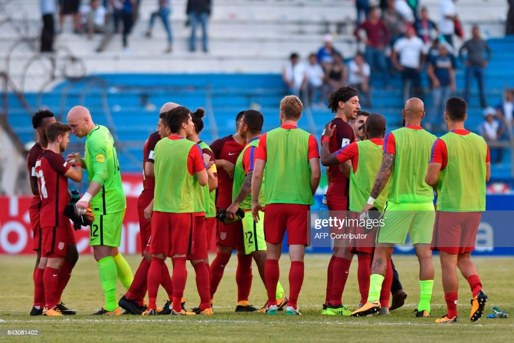 Players of the United States greet each other at the end of their 2018 World Cup football qualifier match against Honduras in San Pedro Sula, Honduras, on September 5, 2017. / AFP PHOTO / Johan ORDONEZ