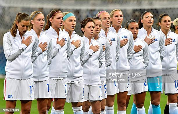 Players of the United States listen to the national anthem prior to the Women's Group G first round match between the United States and New Zealand...