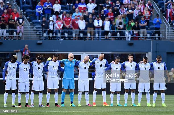 Players of the United States pay a minute of silence in honour of the victims of a rampage at a gay club in Orlando Florida before the start of the...