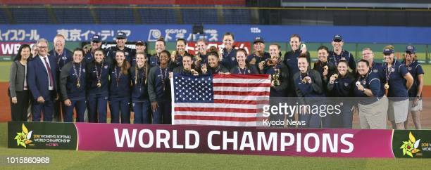 Players of the United States pose after winning the women's softball world championship by defeating Japan 76 in the final at Zozo Marine Stadium in...