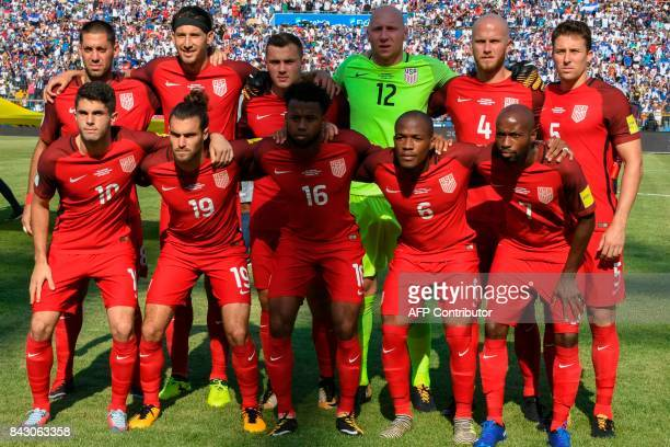Players of the United States pose for pictures before the start of their 2018 World Cup football qualifier match against Honduras in San Pedro Sula...