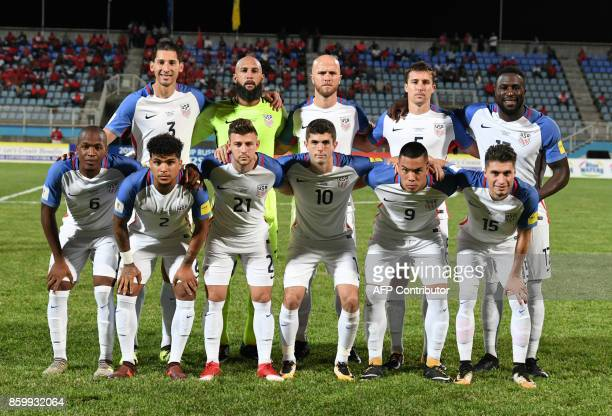 Players of the United States pose for pictures before the start of their 2018 World Cup qualifier football match against Trinidad and Tobago in Couva...