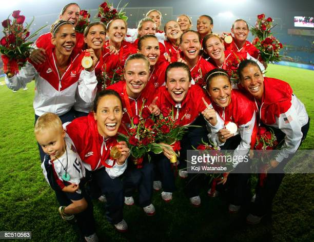 Players of the United States team pose for photographs with gold medals after the award ceremony of the Women's Final between USA and Brazil at...