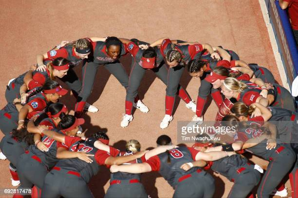 Players of the University of Oklahoma huddle together before squaring off against the University of Florida during the Division I Women's Softball...