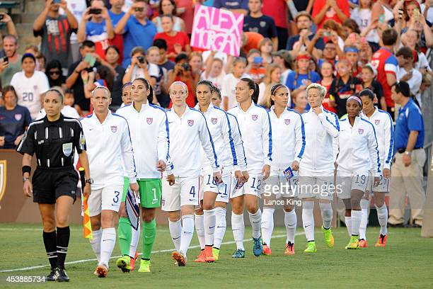 Players of the US women's national team walk onto the field prior to their match against the Swiss women's national team at WakeMed Soccer Park on...
