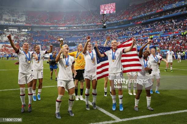 Players of the USA celebrate following their sides victory in the 2019 FIFA Women's World Cup France Final match between The United States of America...