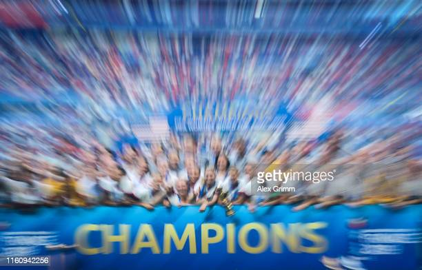Players of the USA lift the FIFA Women's World Cup Trophy following their team's victory in the 2019 FIFA Women's World Cup France Final match...
