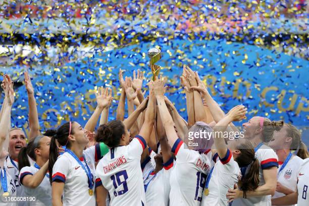 Players of the USA lift the Women's World Cup Trophy following the 2019 FIFA Women's World Cup France Final match between The United States of...