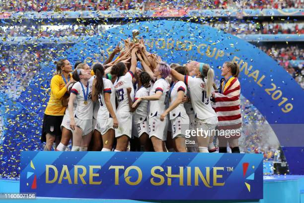 Players of the USA lift the Women's World Cup Trophy following victory in the 2019 FIFA Women's World Cup France Final match between The United...