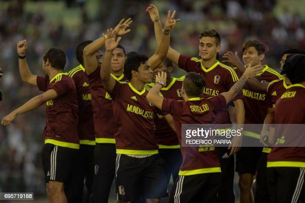 Players of the Venezuelan Under20 national team runnerup at the U20 World Cup in South Korea celebrate and acknowledge fans gathering at the Olympic...