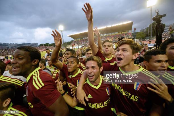 Players of the Venezuelan Under20 national team runnerup at the U20 World Cup in South Korea celebrate with the crowd during a gathering at the...