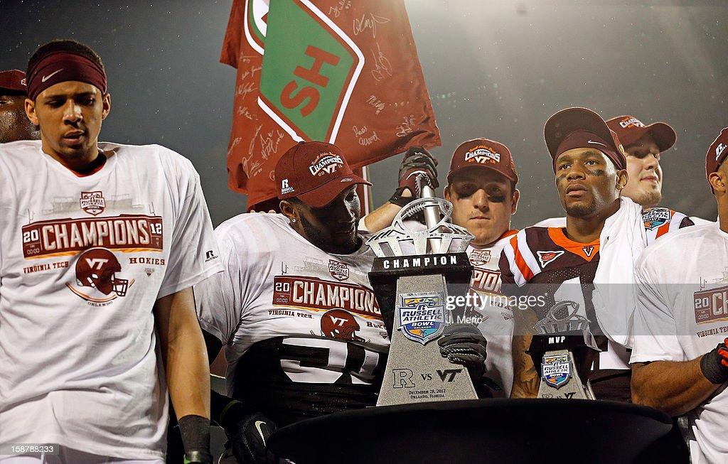 Players of the Virginia Tech Hokies hold the Russell Athletic Bowl Game trophy after their victory over the Rutgers Scarlet Knights at the Florida Citrus Bowl on December 28, 2012 in Orlando, Florida.