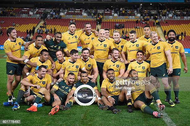 Players of the Wallabies poses after wining the Rugby Championship match between the Australian Wallabies and the South Africa Springboks at Suncorp...