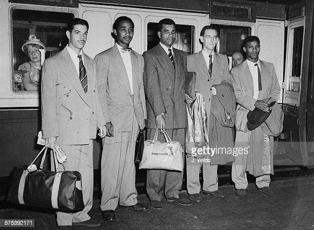 Players of the West Indian Cricket Team standing next to their train as they prepare to leave for a tour of Australia Kenneth Rickards Frank Worrell...