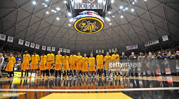 Players of the Wichita State Shockers stand at attention during the National Anthem before a game against the Southern Illinois Salukis during on...