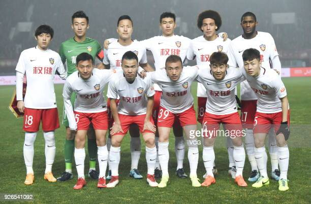 Players of Tianjin Quanjian line up prior to the 2018 Chinese Football Association Super League first round match between Henan Jianye and Tianjin...
