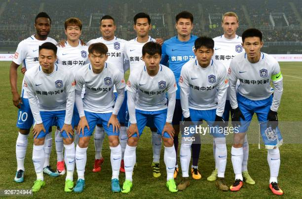 Players of Tianjin Teda line up prior to the 2018 Chinese Football Association Super League first round match between Tianjin Teda and Hebei China...