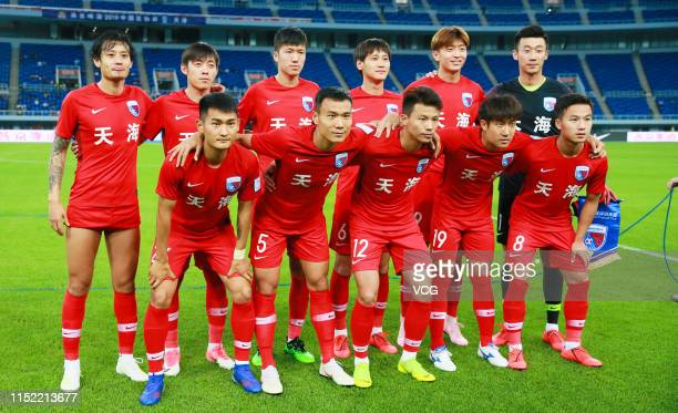 Players of Tianjin Tianhai line up prior to the 2019 CFA Cup eighth-final match between Tianjin Tianhai and Taizhou Yuanda at Tianjin Olympic Center...
