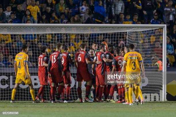 Players of Tigres and Toronto argue with referee Hector Rodriguez after a goal during the quarterfinals second leg match between Tigres UANL and...