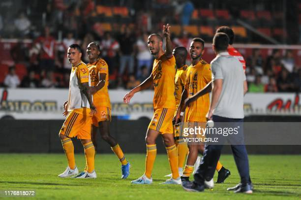 Players of Tigres argue with players of Veracruz at the end of their Mexican Apertura tournament football match at Luis Pirata Fuente stadium in...