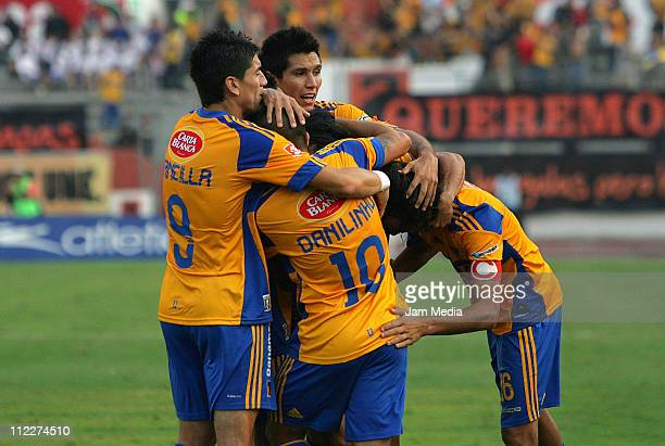 Players of Tigres celebrate a scored goal during a match against Jaguares as part of the Clausura Tournament in the Mexican Football League at Victor...