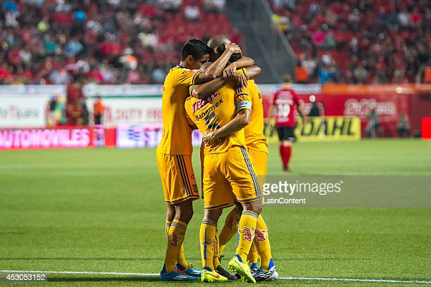 Players of Tigres celebrate after Juninho scored the tying goal during a match between Tijuana and Tigres UANL as part of 3rd round Apertura 2014...