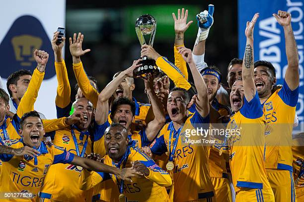 Players of Tigres celebrate after winning the final second leg match between Pumas UNAM and Tigres UANL as part of the Apertura 2015 Liga MX at...