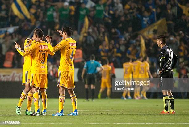Players of Tigres celebrates a scored goal during a match between Tigres UANL and Santos Laguna as part of the Clausura 2014 Liga MX at Universitario...