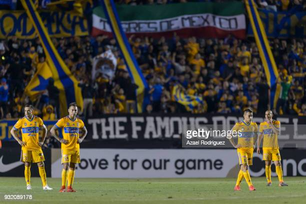 Players of Tigres look dejected after receiving a second goal by Sebastian Giovinco of Toronto during the quarterfinals second leg match between...