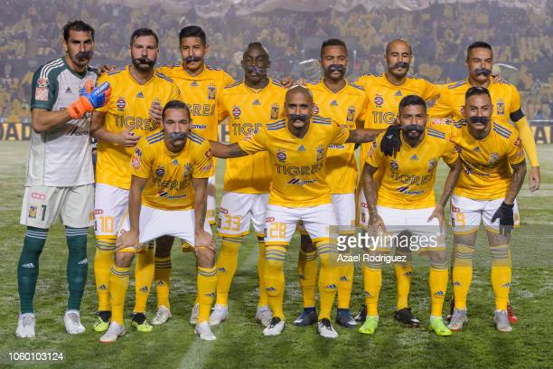 Players of Tigres pose wearing mustaches commemorating Ricardo Tuca Ferretti's 1081 matches as a coach prior the 16th round match between Tigres UANL...
