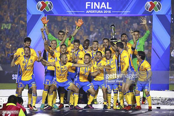Players of Tigres raise the champions trophy after the Final second leg match between Tigres UANL and America as part of the Torneo Apertura 2016...