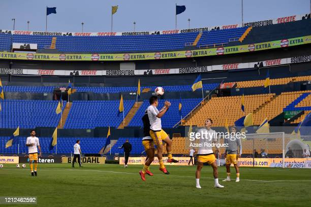 Players of Tigres warm up in an empty stadium prior to the 10th round match between Tigres UANL and FC Juarez as part of the Torneo Clausura 2020...