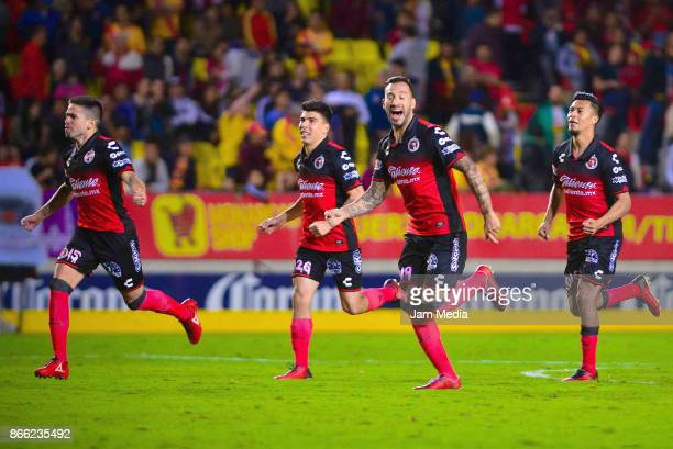 Players of Tijuana celebrate after the round of sixteen match between Morelia and Tijuana as part of the Copa MX Apertura 2017 at Morelos Stadium on...