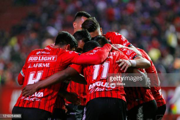 Players of Tijuana celebrate their first goal during the first leg semifinal match between Tijuana and Toluca as part of the Copa MX 2020 at Caliente...