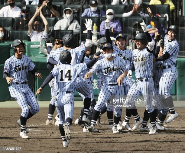 Players of Tokaidai Sagami celebrate their 3-2 walk-off victory over Meiho in the final of the national high school baseball invitational tournament...