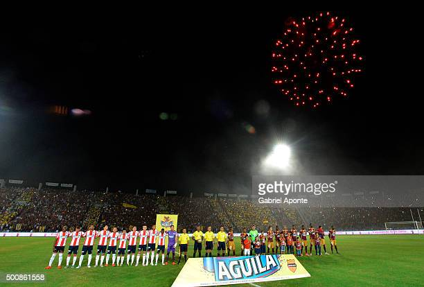 Players of Tolima and Junior look on during the formal events prior a first leg match between Deportes Tolima and Ateltico Junior as part of Semi...