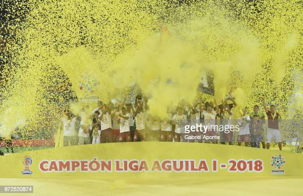 Players of Tolima lift the Championship Trophy after the second leg match between Atletico Nacional and Deportes Tolima as part of the Liga Aguila I...