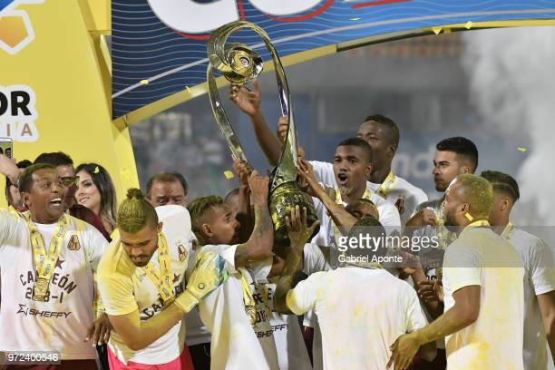 Players of Tolima lift the trophy to celebrate as champions of the Liga Aguila I 2018 after the second leg match between Atletico Nacional and...